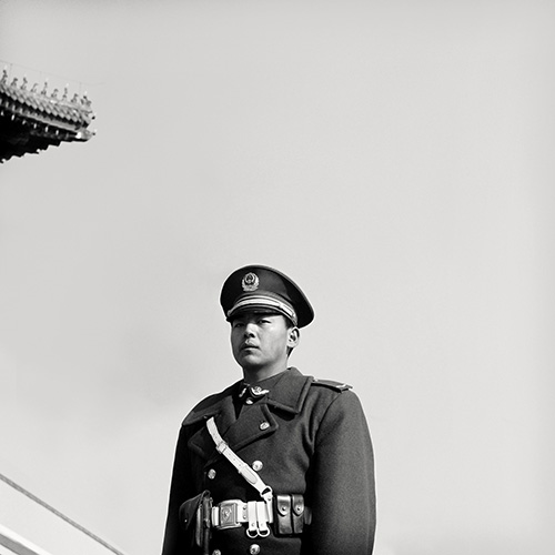Photography Exhibition Edinburgh. Police Guard, Beijing, black and white photography.