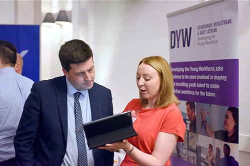 Jamie Hepburn MSP is shown the Marketplace digital platform