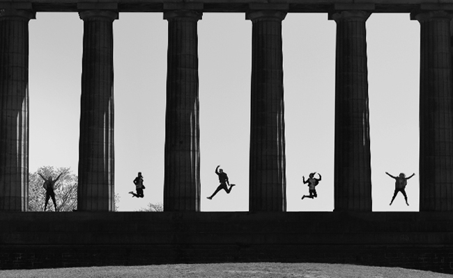 Photography Tour in Edinburgh. Image of the National Monument, Calton Hill with jumping figures.
